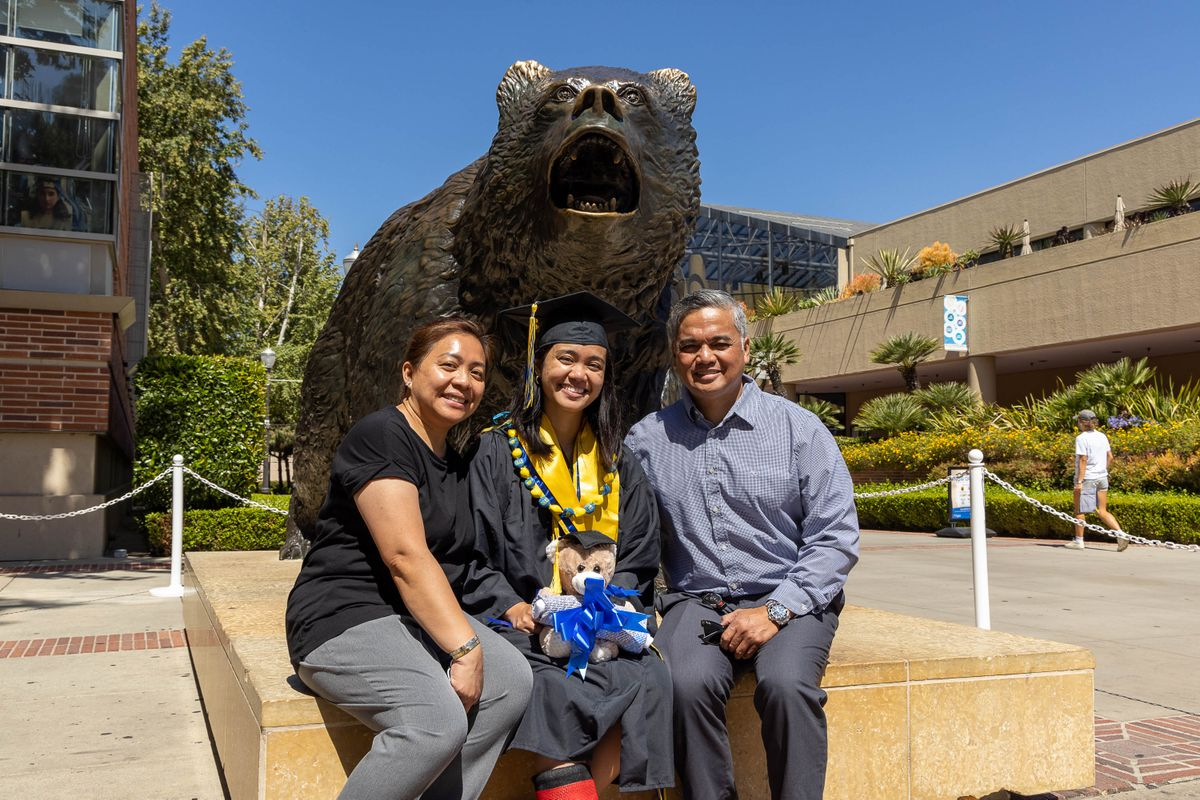UCLA Commencement 2021 - Family at the Bruin statue