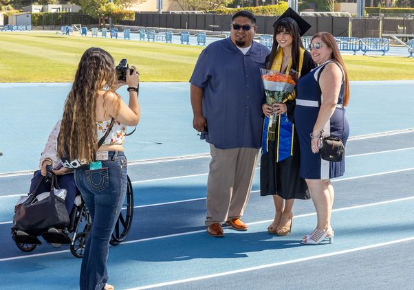 Click to open the large image: UCLA Commencement 2021- family and photographer