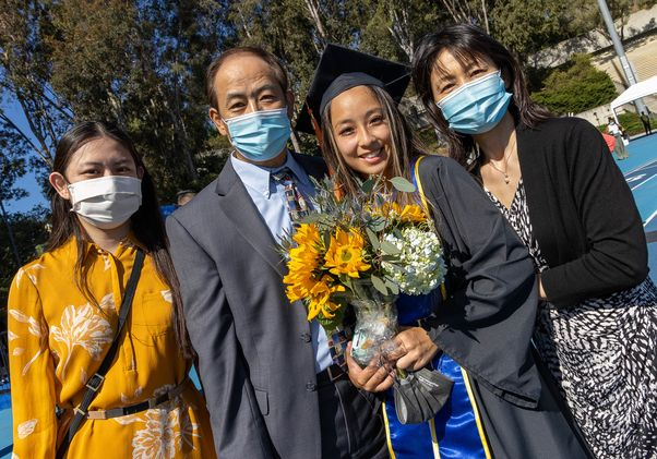Click to open the large image: UCLA Commencement 2021 - family of four
