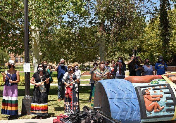 Click to open the large image: Lummi totem at UCLA