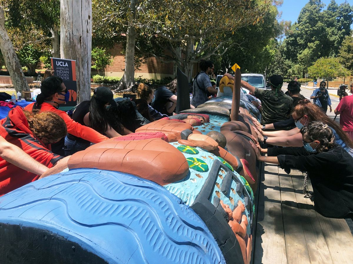 Participants touch the Lummi totem and offer a final blessing.