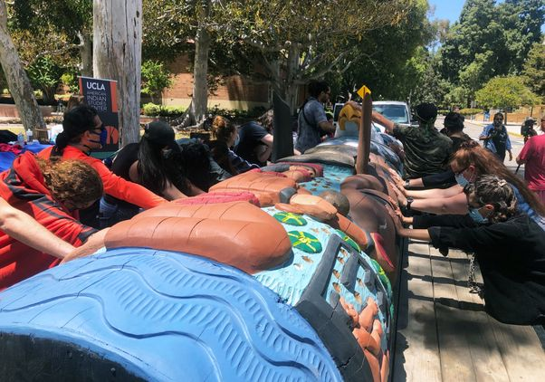 Click to open the large image: Lummi Totem final blessing
