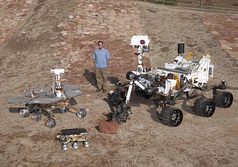 Ashwin Vasavada with the Mars rovers in the Mars Yard at NASA's Jet Propulsion Laboratory.