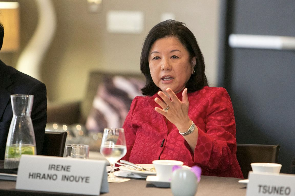 Irene Hirano Inouye seated at conference table