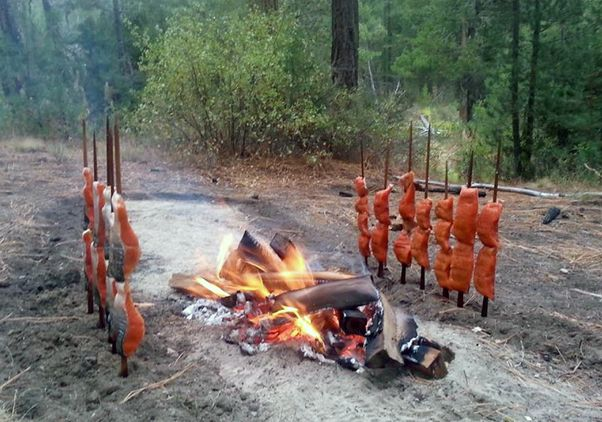 Click to open the large image: Salmon cooking open fire