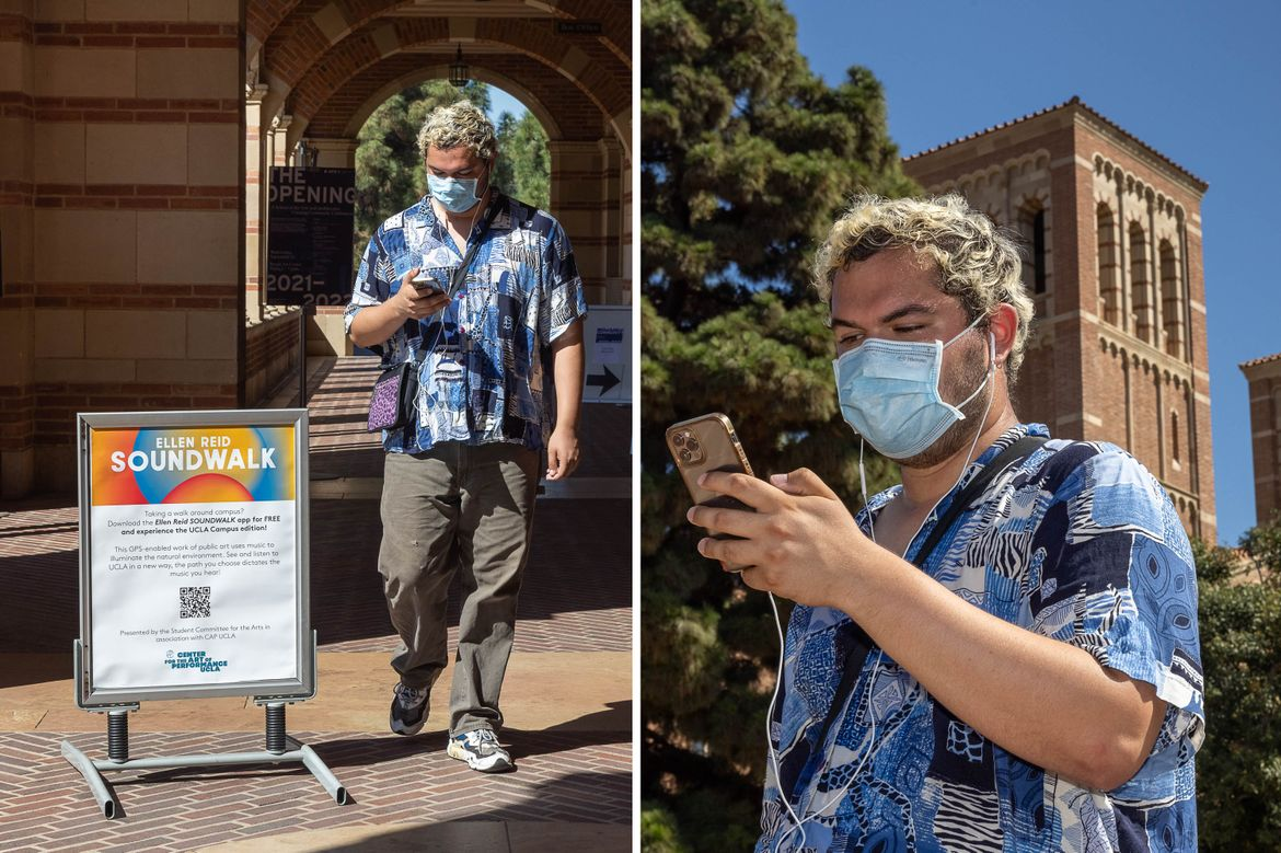 Art student walks on campus with phone