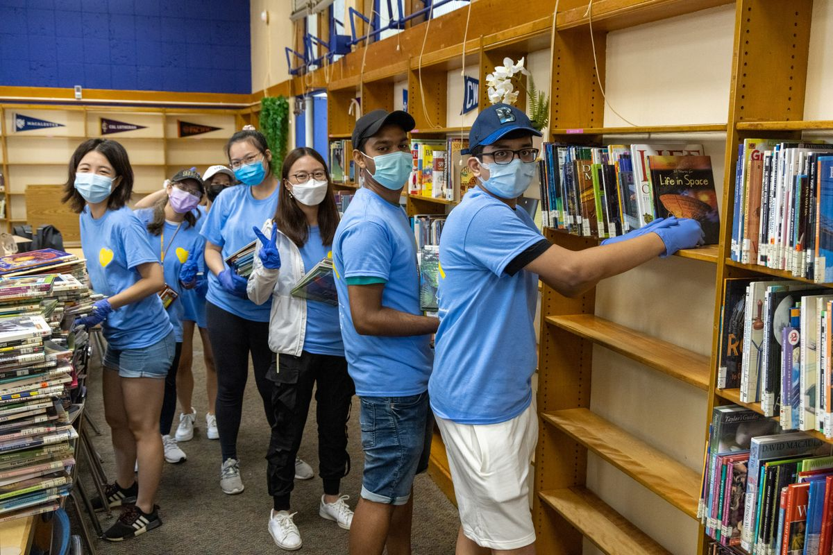 UCLA Volunteer Day 2021 - Students re-shelving books