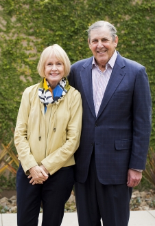 Dr. Jonathan and Karin Fielding in front of ivy-covered wall