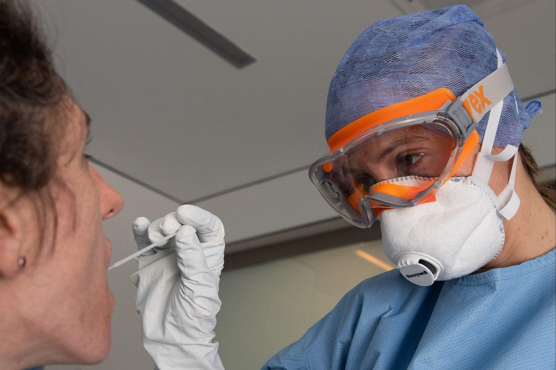 Hospital worker taking sample