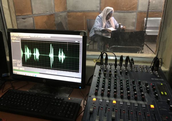 Sheik recording a message in the studio