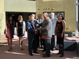 Bill Bayless, president and CEO of American Campus Communities and Robert Frank, president of UNM cut the ribbon for the Grand Opening of Casas del Rio residence halls.