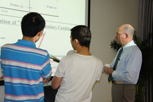 Edl Schamiloglu working with students at Tsinghua University