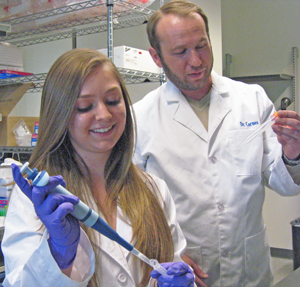 UNM student Katharine Epler and Chemical and Nuclear Engineering Research Assistant Professor Eric Carnes in the lab.