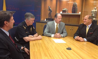 (l. to r.): Bruce Perlman, APD Chief Ray Shultz, Mayor Richard Berry and UNM President Robert Frank.