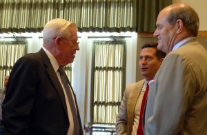 Legislative Finance Committee member John Arthur Smith with UNM Director of Government Relations Marc Saavedra and UNM President Robert Frank