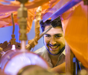 UNM student Steven Candaleria in the School of Engineering Plasma Lab.