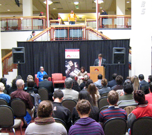 UNM Student Regent Jake Wellman introduces U.S. Secretary of Labor Hilda Solis at a brief appearance in UNM's Student Union Building.