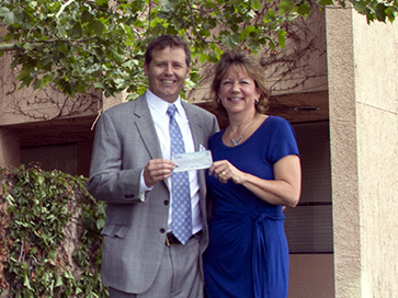 The family of Micheal W. Hansen presents check to the UNM Cen­ter for Sur­gi­cal Crit­i­cal Care.