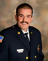 Local fire chief earns degree; receives Harvard Fellowship