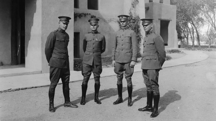 WWI soldiers in front of Hodgin Hall
