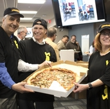 UNM leadership puts on pizza hats to surprise departments