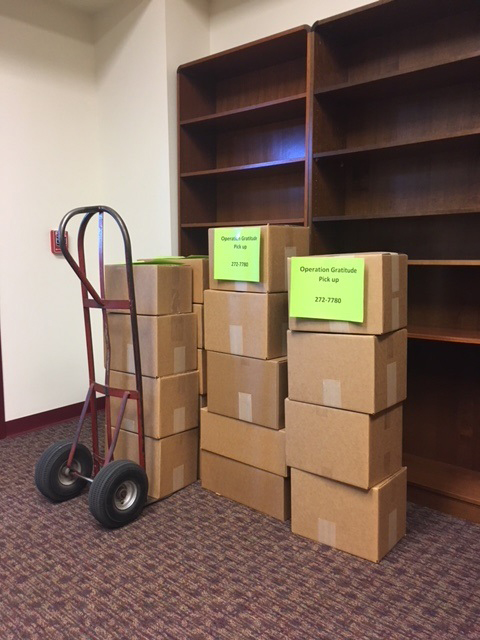 UNM Press books boxed for donation