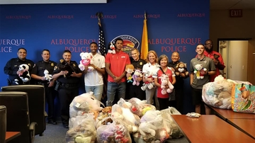 Hundreds of donated bears to UNM BeKind processed at the Albuquerque Police Department