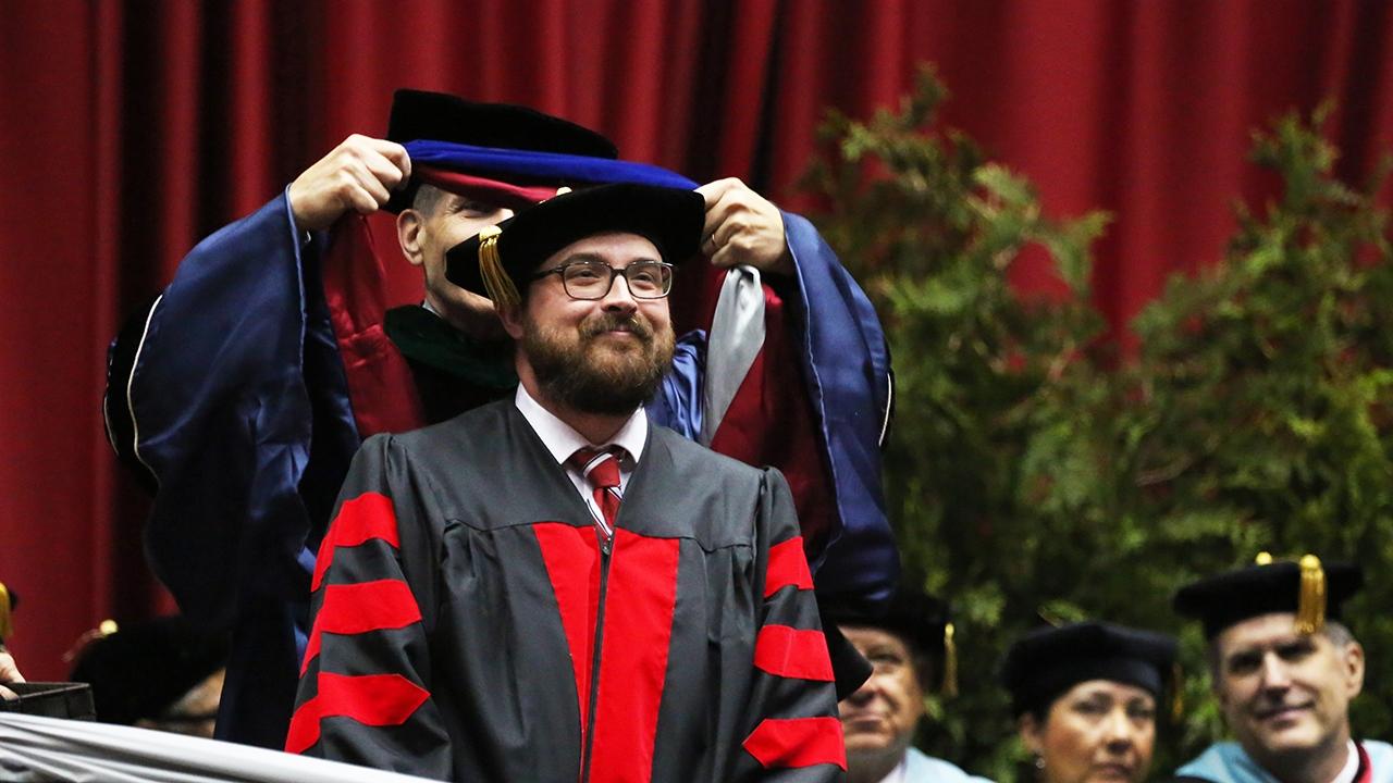 Hooded graduate