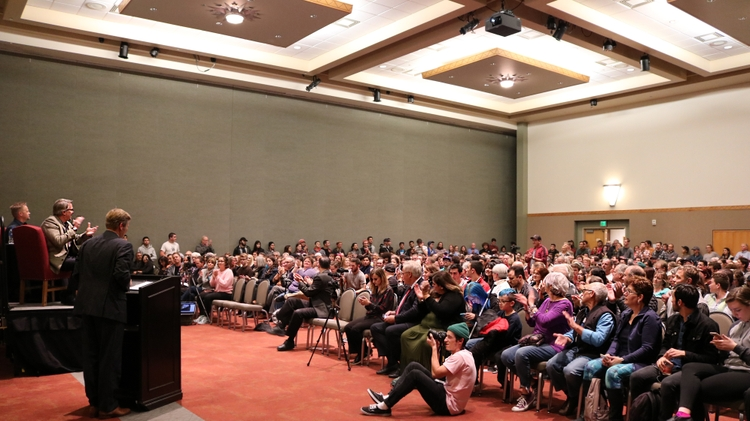 Mayor Tim Keller introduces Vince Gilligan to a packed UNM audience