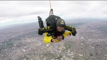President Stokes jumps with the Golden Knights