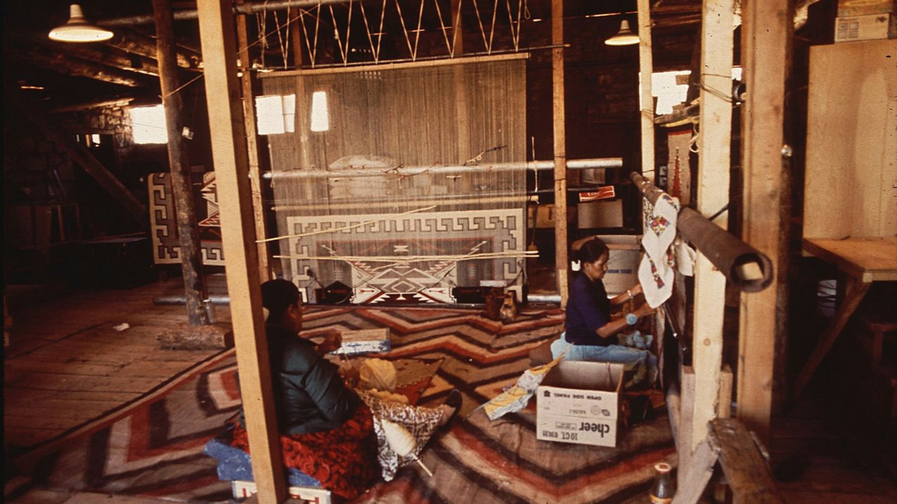 Navajo women weaving