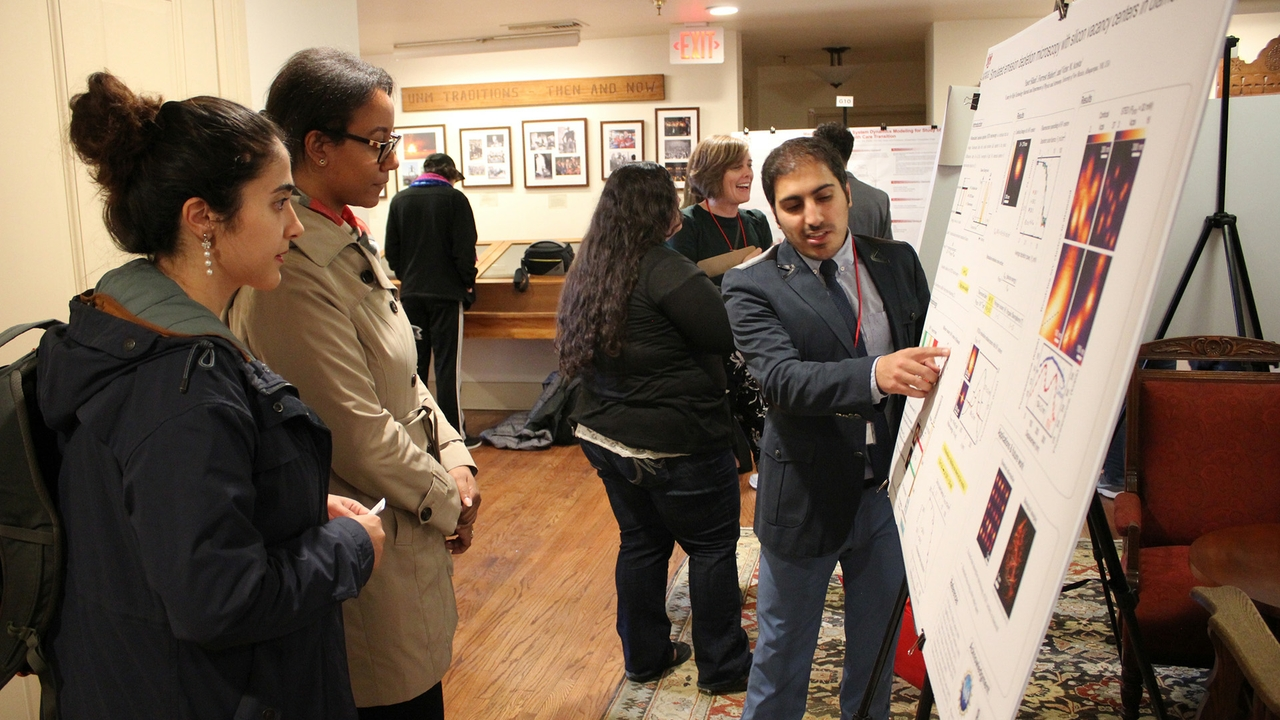 Yaser Silani explains his research poster