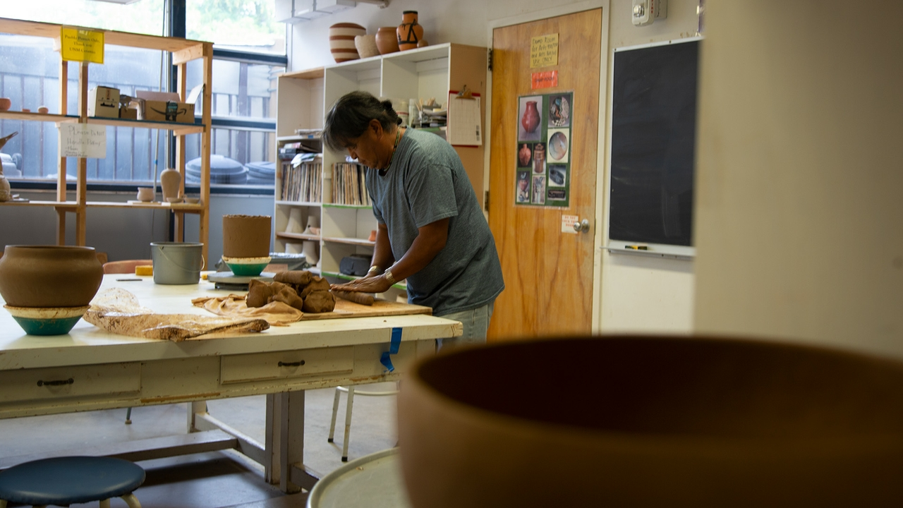 Native American artist teaches traditional methods of making Pueblo pottery