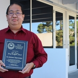 Engineering professor presents research and receives award during international symposium