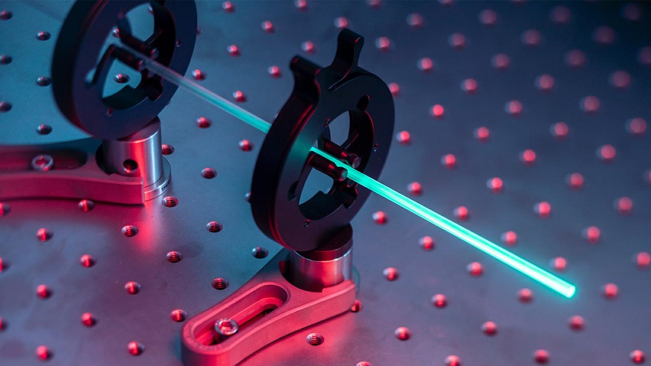Laser cooling glass