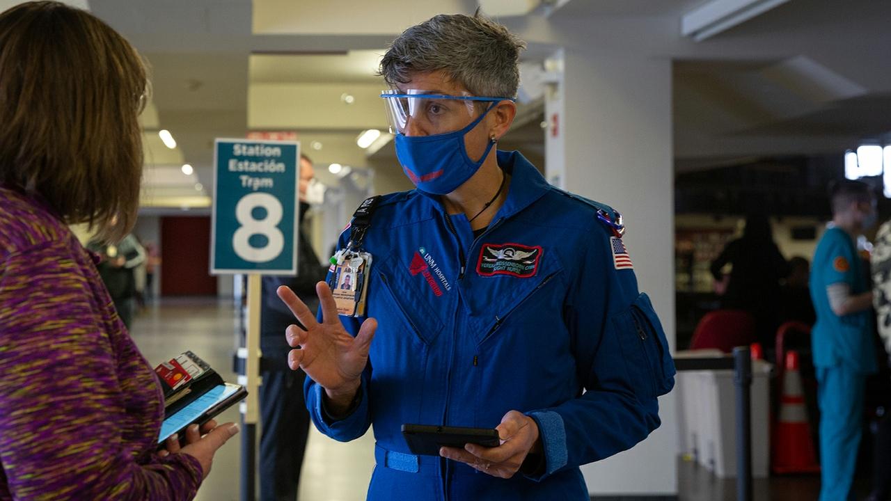 Lobo Flight Nurse Verena Weissenborn assisting with vaccinations