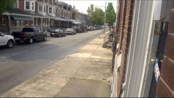 Parked cars along a downtown residential street