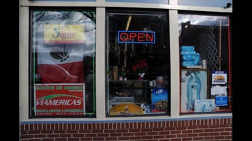 Main Street storefront advertising money transfer services to Mexico copy