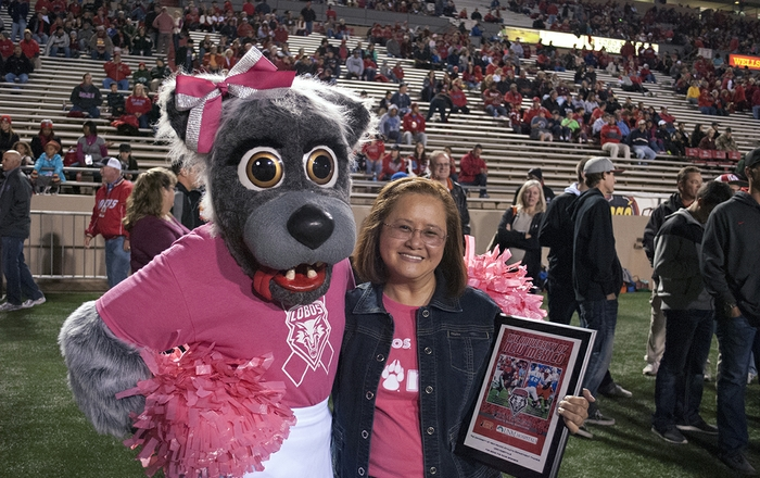 Dr. Melanie Royce and Lobo Lucy at the Lobos Love Pink football game