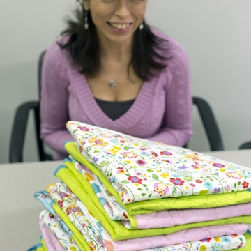 Handmade quilts warm UNMH newborns, honor donor's daughters