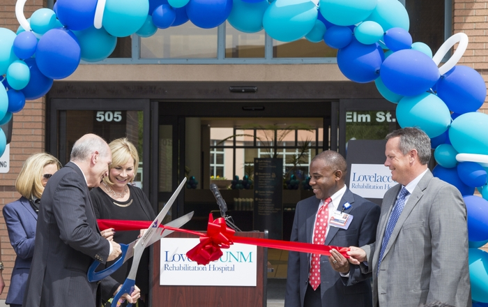 Paul B. Roth, MD, MS, does the honors at the ribbon cutting