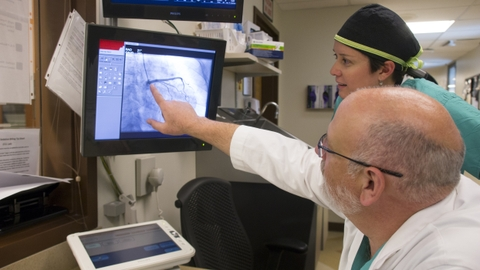 Mark Sheldon, MD, and Emilia Vargas, RN, review a heart image