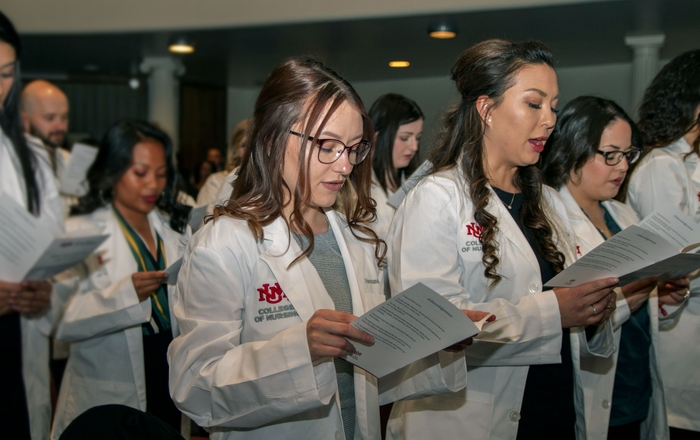 First-year Nursing Students Don White Coats