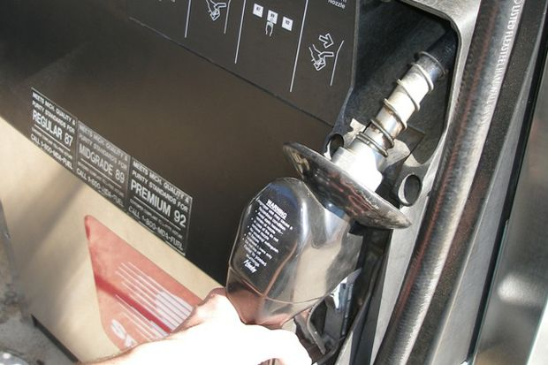 hand at gas pump