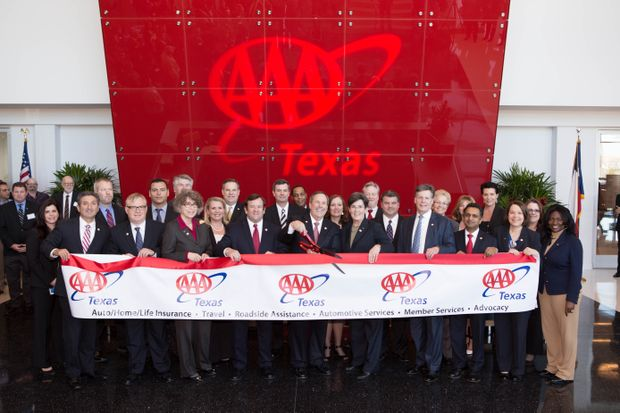 AAA Texas Opening-Red ribbon cutting