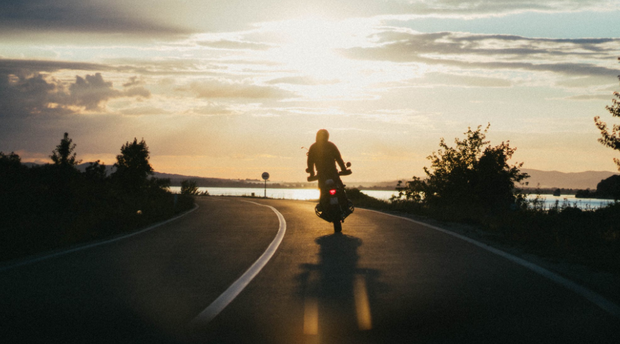 motorcycle rider sunset