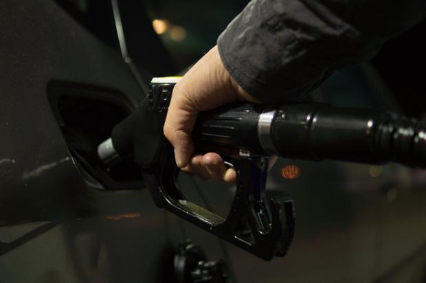 gas nozzle into car