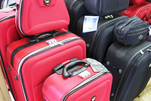 red black luggage piled