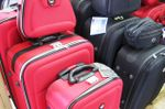 red black luggage piled