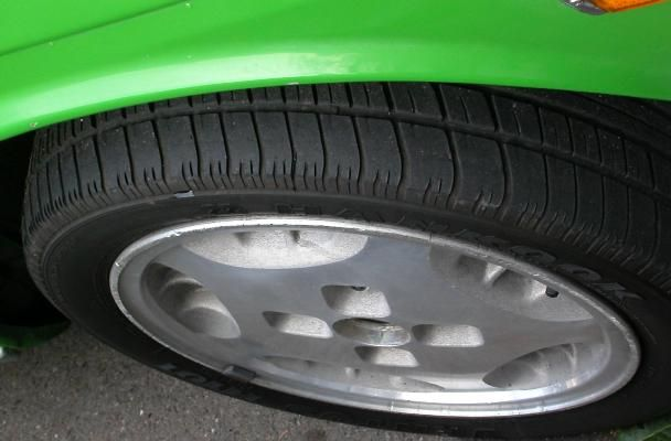 Green Car showing Tire